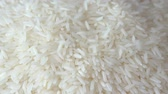Slow motion of close up falling raw rice  uncook rice. (High speed video)