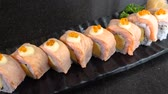 Grill salmon roll sushi on black dish in the restaurant (Japanese food)
