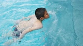 dunking : Happy Asian child swimming at pool Stock Footage