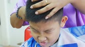 nape : Asian boy having a hair cutting with hair clippers