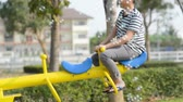 Happy boy playing seesaw outdoor with bubble, lifestyle concept