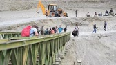 bridge across the river : SRINAGAR, INDIA - JULY 20, 2015: Flood crisis, broken old bridges then many tourists and India peoples try to cross unfinished bridge, the way to Manali,