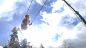 parkosított : Slow motion of happy girl swinging on the playground
