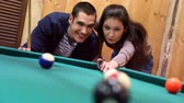 young couple playing pool, 2x slow motion