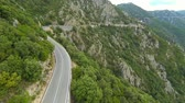 flying over winding mountain road in sardinia, italy