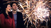 young couple looking at new years fireworks Wideo