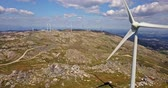 penge : Aerial view, by drone of a wind turbines on top of mountains, cloudy sky as background, in Portugal Stock mozgókép