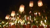 opening : CHIANG MAI THAILAND-NOVEMBER 08 :Unidentified monks release floating lamp made of paper annually at Phan Tao temple in Loy Krathong and Yi Peng Festival on November 08,2014 in Chiangmai,Thailand Stock Footage