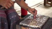 aluminium dishes : Hands of the craftsman hitting silverware a bas-relief with hammer. 4k video