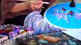 bo : Hand of female painting on Handmade umbrella of the Bo Sang village, Chiang mai, Thailand. video 4k