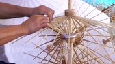 bo : Female working handmade umbrella of the Bo Sang village Chiang mai, Thailand. Stok Video