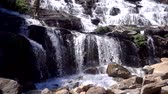 Mae ya Waterfall in doi inthanon, Chiang mai,Thailand, Most Famous, Beautiful silky waterfall flow through stones, Slow motion