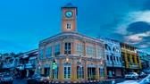 Time lapse 4k format motion at intersection Old building in Phuket town twilight, Thailand.