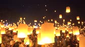 Floating lanterns on sky in Loy Krathong Festival or Yee Peng Festival, traditional Lanna Buddhist ceremony in Chiang Mai, Thailand