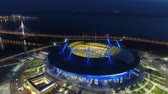 stadyum : Stadium Zenith Arena at night. Illuminated by multi-colored lights the stadium at night Stok Video
