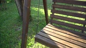 muebles jardin : Bench Vintage and wooden swing swinging in park. Motion footage of swinging chair