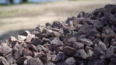 булыжник : Granite gravel heap, Small pebble. A lot of small stones.