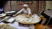 gozleme : ISTANBUL, TURKEY - MAY 29, 2015: Ladies cooking gozleme in taksim Beyoglu. Gozleme is a savoury traditional Turkish dish made of hand-rolled dough that is lightly brushed with butter and eggs.
