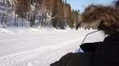 a man rides on a snowmobile on ice river