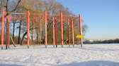 petersburg : Empty swing in winter park Stock Footage