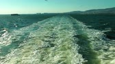 emerald water : Sea waves behind the ferryboat