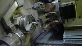 millsime : closeup machine-tool lathe starts to turn detail worker closes box door at manufacture plant