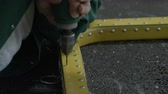 millsime : closeup worker hands drill holes on helicopter detail with hand perforator in manufacture shop