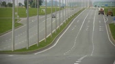 спидвей : modern car moves along empty highway with multi traffic lines on summer sunny day Стоковые видеозаписи