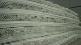 fabricante : camera moves along large long shelves of produced white polyethylene pipes in factory storehouse