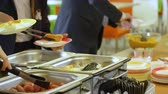 group of children : pupils take plates and put food into them in school canteen Stock Footage