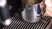 верхний : slow motion macro hand-held shining metal cup with tasty strong coffee from modern machine