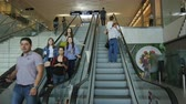 shopaholic : KAZAN, TATARSTAN  RUSSIA - SEPTEMBER 18 2017: Closeup of an adult people moving on escalators in a modern big mall with clothes shops and entertainments on September 18 in Kazan
