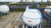 petrochemical plant : drone rotates above huge oil tanks