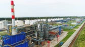 petrochemical : flycam moves above huge refinery territory with powerful workshops and petroleum reservoirs