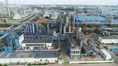 stacja paliw : aerial view powerful plant with manufacturing departments covered smoke coming out from chimneys