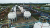 storage reservoir : aerial view white petrochemical reservoirs located on industrial factory Stock Footage