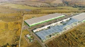 boru hattı : flycam shows an amazing panoramic view of an industrial complex among green meadows against woods and lake