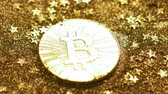 international economy : macro shining mined real coins created as virtual cryptocurrency bitcoin with material equivalent absence among spangles Stock Footage