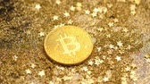 programm : macro amazing shining gold bitcoin model lays among sparkles and stars against bright light Stock Footage
