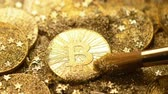 international economy : macro camera shows popular bitcoin real model cleared with brush and sparkling at light rays Stock Footage