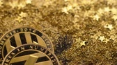 become : macro litecoins made as virtual currency becoming popular for souvenirs fall on twinkling sparkles Stock Footage