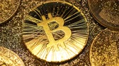 wallet : macro brilliant sparkling bitcoin real model shines and covered with shadow among gold sparkles and coins Stock Footage