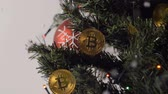 international economy : closeup coins of bitcoin payment system with decentralisation and electronic wallet hang on decorated Christmas tree