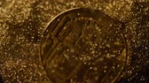 торговля : macro famous gold bitcoin real model falls down and turns to back among sparkling golden sand