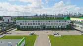 petrochemical plant : KAZAN, TATARSTAN  RUSSIA - SEPTEMBER 19 2017: Beautiful upper view of the plant control department with parking lawns and flags against a cloudy sky on September 19 in Kazan