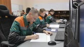 petrochemical plant : KAZAN, TATARSTAN  RUSSIA - SEPTEMBER 27 2017: Closeup of petrochemical plant workers sit at computers and perform work writing down data from monitors on September 27 in Kazan Stock Footage