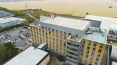 administrativo : KAZAN, TATARSTAN  RUSSIA - AUGUST 22 2017: Aerial panorama helicopter landing site on roof of oil Stock Footage