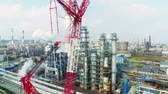 нефтехимический : upper view red lifting construction near smoking towers