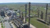 oil factory : aerial view metal towers constructions and powerful equipment located on industrial plant territory