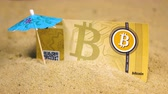 banknot : souvenir banknote stuck in sand near decorative blue umbrella and created as currency with full decentralization Stok Video